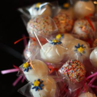 dessert bar cake pops with flowers and sprinkles